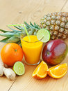 Fresh tropical fruit juice a glass of with fruits shallow depth of field Royalty Free Stock Images