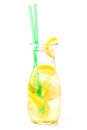 Fresh tropical or summer lemonade with lemon, lime and ice in glass, beverage isolated on white background Royalty Free Stock Photo