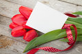 Fresh tulips bouquet and blank card for copy space Royalty Free Stock Photo