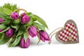 Fresh tulips and wooden heart space spring decorations on white background text Royalty Free Stock Image