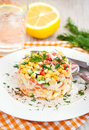Fresh vegetable and crab salad with mayonnaise corn pepper cucumber eggs Stock Image