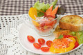Fresh vegetable and crab stick salad in glass bowl with garlic bread Stock Image