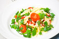 Fresh vegetable salad with cherry tomatoes green onions and cheese Royalty Free Stock Images
