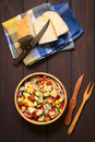 Fresh vegetable salad with croutons overhead shot of made of sweet corn cherry tomato cucumber red onion red pepper chives in Royalty Free Stock Photo