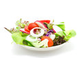 Fresh vegetable salad isolated on white Royalty Free Stock Photo