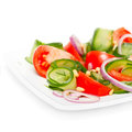 Fresh vegetable salad with pine nuts on white Stock Photos