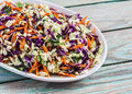 Fresh vegetable salad with red cabbage, carrots, sweet peppers, herbs and seeds. Healthy food Royalty Free Stock Photo