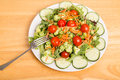 Fresh vegetable salad with sliced cayenne peppers wtih cucumbers cherry tomatoes and Stock Image