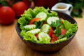 Fresh vegetable salad in a wooden bowl Stock Photo