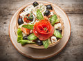 Fresh vegetable salad on wooden table Stock Photography