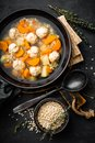Fresh vegetable soup with meatballs and pearl barley in bowl on black background Royalty Free Stock Photo