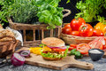 Fresh vegetables as ingredients homemade hamburger old wooden table Stock Photos