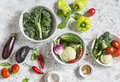Fresh vegetables - broccoli, peppers, tomatoes, eggplant, squash, turnips on a light background Royalty Free Stock Photo