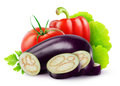 Fresh vegetables eggplant tomato and bell pepper over white background Stock Image