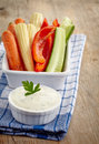 Fresh vegetables and garlic dip on wooden background Stock Photography