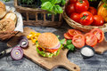 Fresh vegetables herbs as ingredients homemade hamburger old wooden table Stock Images