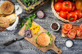 Fresh vegetables homemade hamburger old wooden table Royalty Free Stock Photo