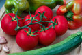 Fresh vegetables including tomatoes, zucchini, sweet green and red pepper, garlic Royalty Free Stock Photo