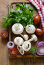 Fresh vegetables mushrooms, tomatoes and onion Royalty Free Stock Photo