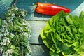 Fresh vegetables on the old rustic table closeup Stock Photos