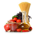 Fresh vegetables, olive oil and tomato sauce Royalty Free Stock Photo