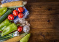 Fresh vegetables. Overhead view of a assortment of farm fresh vegetables, Green pepper, garlic, corn, onions, tomatoes, cucumbers Royalty Free Stock Photo