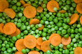 Fresh vegetables peas and carrots Royalty Free Stock Image