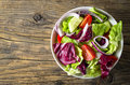 Fresh vegetables salad on wooden table Royalty Free Stock Photo