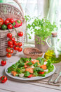 Fresh vegetables and salmon as ingredients for salad on old wooden table Royalty Free Stock Photos