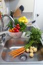 Fresh Vegetables in the Sink Royalty Free Stock Photos
