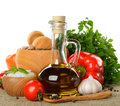 Fresh vegetables spices and olive oil on white background Stock Photos
