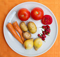 Fresh vegetables on white plate Royalty Free Stock Photography