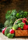Fresh vegetables in a wicker basket: tomatoes, broccoli, cucumbe Royalty Free Stock Photo