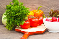 Fresh vegetables on a wooden background Stock Photo