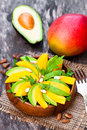 Fresh  vegetarian salad with mango and avocado in the wooden pla Royalty Free Stock Photo