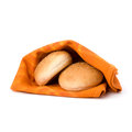 Fresh warm bread over kitchen towel isolated on white background Royalty Free Stock Images