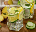 Fresh water with lemon, mint  and cucumber  on a wooden backgrou Royalty Free Stock Photo