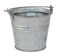 Fresh water in a miniature metal bucket isolated on white background Royalty Free Stock Photo