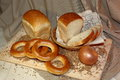 Fresh wheat bread and bagels on a wooden cutting Board