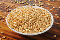 Fresh wheat kernels a bowl of organic whole Royalty Free Stock Images