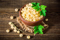 Fresh white currant in ceramic bowl on dark wooden background. Royalty Free Stock Photo