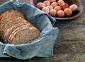 Fresh whole wheat bread and eggs Royalty Free Stock Photos