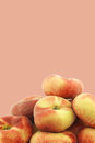 Fresh wild flat nectarines on a beige background Royalty Free Stock Photo