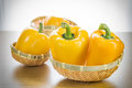 Fresh yellow bell peppers in basket Royalty Free Stock Photo