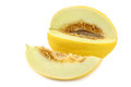 Fresh yellow honey melon and a cut piece Royalty Free Stock Photo