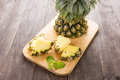 Fresh Yellow Organic Pineapple cut into slices. Royalty Free Stock Photo