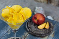 Fresh yellow peach ice-cream scoops in glass cone on the beach, Royalty Free Stock Photo