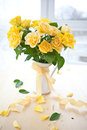 Fresh yellow roses in a vintage emaille can Stock Photo