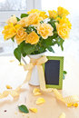 Fresh yellow roses in a vintage emaille can Stock Image