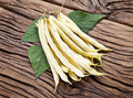 Fresh yellow string beans on the old wood. Royalty Free Stock Photo